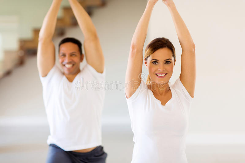 couple-doing-yoga-exercise-portrait-lovely-home-54454958